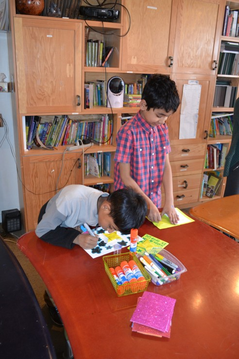 Young students colouring
