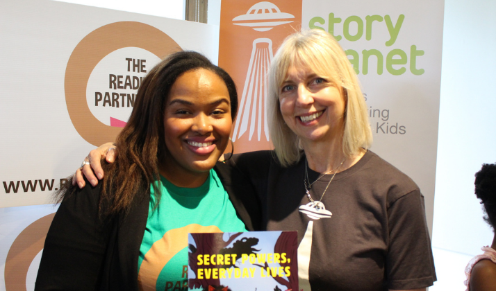Camesha Cox of The Reading Partnership and Liz Haines of Story Planet holding a book together
